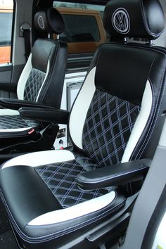This is a complete leather interior that has just been collected by the owner. We have re-upholstered their VW T5 Captain's seats in black leather with white fillets and Bentley Stitching and the 3/4 rock n' roll bed has been upholstered to match. We also repainted and lacquered the plastics to both of the Captain's chairs matte black to tie in with the new look.
