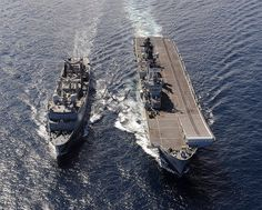 HMS Illustrious (right) takes fuel from the French supply tanker FS Somme.
