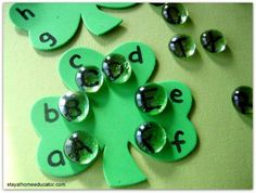 I share with you several fun, inexpensive, and easy St. Patrick's Day literacy activities. Also included in this post are the phonemic awareness and phonics activities completed for Preschool Co-op Week 21.