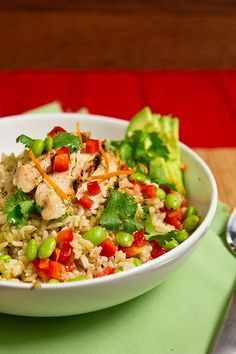 Chicken and edamame in a light orange-ginger dressing, served over brown rice.    1/4 cup orange juice  2Tbsp lime juice  1 Tbsp + 1 tsp canola oil1 Tbsp grated peeled fresh gingerSalt  2 chicken breasts,1 cup shelled edamame 1 large red bell pepper diced 1/4 small avocado, sliced - this sounds yummy and looks very appetizing!