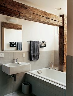 Rather than concealing the barn frame in the private rooms, Cohen created an interplay between modern and historic elements in the master bathroom.  Photo by: Raimund Koch      Read more: http://www.dwell.com/slideshows/raising-the-barn.html?slide=4=y=true##ixzz25k3zqTVl
