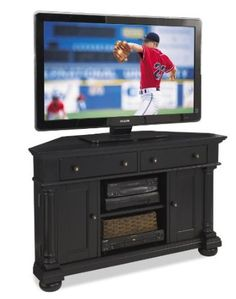 Amazon.com - Home Styles St Croix Corner TV Stand, Black. Not necessarily this style but corner media console.
