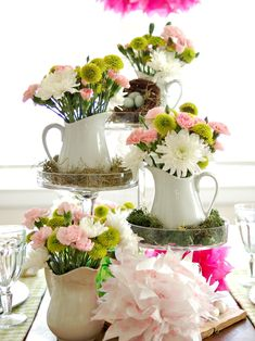 Colorful Spring Table Setting - create a centerpiece of flowers in pitchers on pedestals.