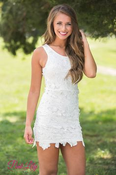 This sweet little white dress is perfect for enjoying a weekend brunch with family and friends! We adore the white floral lace - it's perfect for spring and summer! It also has a scoopneck and is sleeveless to keep you cool all summer long. There's also a zipper in back for a tiny golden accented shine. It's simple and classic - you just need wedges to complete this outfit!