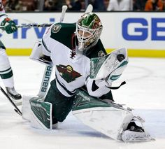 Minnesota Wild goalie Devan Dubnyk makes a save Anaheim Ducks during the second period of an NHL hockey game in Anaheim, Calif., Wednesday, Jan. 20, 2016. (AP Photo/Chris Carlson)
