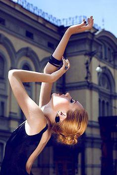 women's fashion portrait, black dress, urban setting
