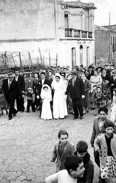An Italian wedding in Calabria - walking through the streets of the village after the wedding ceremony