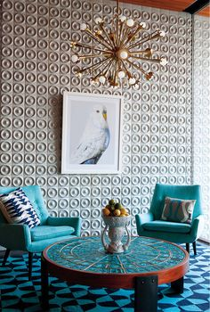 Add a tropical reference. To do tropical in a modern way, choose just one reference and make one big statement with it. The oversize bird photograph shown here is a great example. Other motifs to consider include coral, sea horses, palm leaves, shells and flamingos.