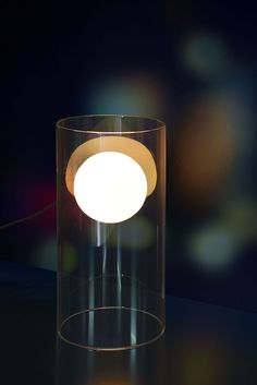 The frosted orb within the clear glass cylinder will give the illusion of a floating warm ball illuminating its surroundings.