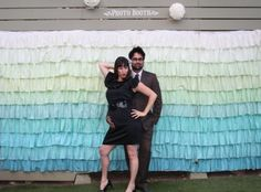 guests-posing-ruffles-tropical-black-dress