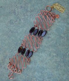 neat wire work bracelet: would like to do this with metal in between instead of the beads