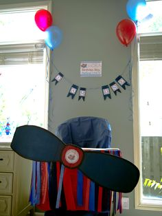 """Time Flies Airplane themed birthday: Highchair Airplane: elastic with a safety pin used to hold skirt around the highchair. sticky back Velcro held it in place and made it removable until party. hot glued ribbon. made propeller from cardboard and spray paint. sign above says: """"birthday boy parking only"""""""