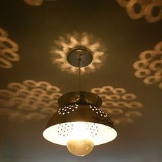 How cool are the shadows from this colander light? Easy to make with a lamp kit and a drill though this link doesn't have DIY instructions. Colander Light, Diy Luz, Luminaria Diy, Kitchen Strainer, Kitchen Sink, Space Kitchen, Kitchen Pantry, Kitchen Dining, Diy Luminaire