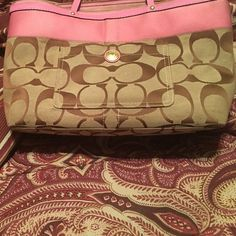 Coach purse matches diaper bag I also have F. s. Pink and Tan Coach purse length9 in and16 width you can put wallet and many more things I used it was my diaper tote I have for sale on here. In good shape not new. Coach Bags Shoulder Bags