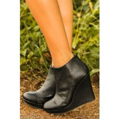 There's nothing wrong with stepping out of line a little.. All's fair in love and shopping after all. Booties feature side zip.  100% Vegan Leather.  Wedge