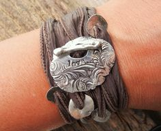 Recycled Silver Silk Ribbon Bracelet, Hand Stamped Love, Yoga Style Wrist Wrap, Hand Made SIlver Toggle, An Eco Friendly Gift for Teens. $49.50, via Etsy.