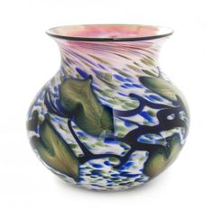 An American Studio Glass Paperweight Vase, Charles Lotton, of squat baluster form, the interior with iridescence and stylized vine decoration, signed 1989