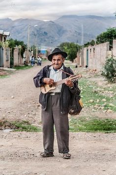 """""""In Sipe Sipe - Cochabamba, the man said 'take this abroad'. Then he began playing his charango."""" Photo by Mijhail Calle, used with permissi..."""