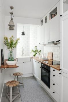Tiny kitchen dinning room. Narrow, small spaces. White, Scandinavian design.