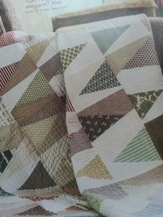 From Fon's & Porter Summer 2016 Triangle Quilts - Trail Marker - I love this Modern Quilt and I think it looks boyish.  This one is done in muted turquoise, green, orange, gray, and brown.