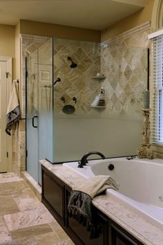 Wood detail along the bottom of tub & add clear shower doors - I don't like the frosted glass.