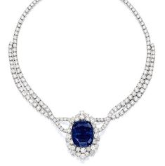Impressive and Rare Sapphire and Diamond Necklace  --   Suspending a cushion-shaped sapphire weighing 102.61 carats, surrounded by brilliant-cut diamonds, completed by a double-strand necklace set with brilliant-cut diamonds, the diamonds together weighing approximately 60.00 carats, mounted in 18 karat white gold
