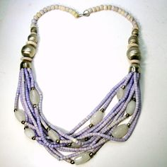 Multistrand Lavender Ceramic Bead Necklace, White Agate Tribal Beads Mixed Into 10 Strands Short Tube Beads, Boho w Silver Also, 1980s 25 Long tiny disc bead pottery necklace ,full full full Breastplate,( 63.5cm) This long and full necklace is a lovely soft and earthy Lavender, Unusual color, with white chunky agates and then brushed silver round beads. UNUSUAL color for tribal The Woodstock years had many nice necklaces like these around the necks of a generation. . I said ceramic , but it…