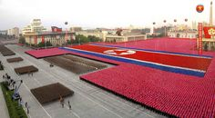 North Korean citizens and soldiers participate in celebrations for the 60th anniversary of the founding of North Korea in Pyongyang, September 9, 2008, in this picture distributed by North Korea's official news agency KCNA, September 10, 2008.