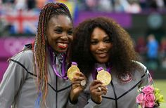 Gold medalists again in 2012: Serena and Venus Williams of the United States celebrate during the medal ceremony for the Women's Doubles Tennis. London 2012 Olympic Games at the All England Lawn Tennis and Croquet Club on August 5, 2012 in London, England. (August 4, 2012 - Source: Clive Brunskill/Getty Images Europe)