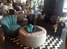 leather chesterfield sofa | tufted linen ottoman | chevon rug | ariel chair