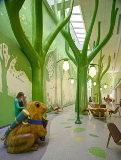 "At Nationwide Children's Hospital in Columbus, Ohio, the ""Magic Forest"" offers a wonderland of giant trees and animals brought to life by sounds of chirping birds and other forest noises to transport visitors away from the hospital environment. Lighting changes among the forest elements help maintain the magic of the space around the clock. Photo: ©Brad Feinknopf"