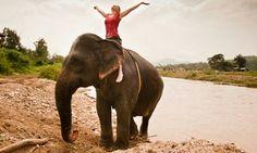 Girl riding elephant