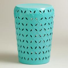 One of my favorite discoveries at WorldMarket.com: Baltic Blue Lili Punched Drum Stool Outside on the back deck
