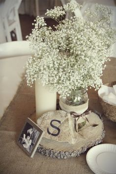 natural table cloth, burlap runner, wooden charger, candle, rock, mason jar, babys breath, small picture frame