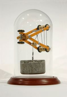 Machines sculptures by Dan Grayber | Beautiful devices using counterweights and springs support themselves
