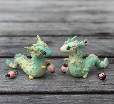 """""""Two majestic lantern dragons crossing paths! The one on the right will be listed with the first Etsy update and the one on the left will be auctioned here…"""" Polymer Clay Dragon, Polymer Clay Animals, Cute Polymer Clay, Cute Clay, Polymer Clay Miniatures, Polymer Clay Charms, Polymer Clay Creations, Diy Clay, Clay Crafts"""
