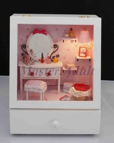 1:12 Dollhouse Miniature DRESSING ROOM MAKEUP TABLE Music Box DIY with Drawer, Furniture, Accessories & Lighting  $29.99  Love this, especially with the drawer for jewelry or treasures. The lighting makes it even more unique with its rosy glow.