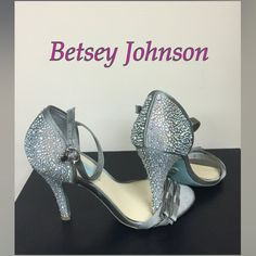 Betsey Johnson Heels Beautiful Betsey Johnson Silver with Iridescent Jeweled Heels, Heart Charm on Buckles, Cute Bows at Toes & Silver Betsey Johnson Signature on Soles!! Perfect for Prom or any Occasion! Minimal Wear as Shown in photos!! In Great Condition! Man made Materials! Betsey Johnson Shoes Heels