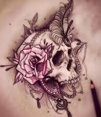 Gorgeous skull with pink flower tattoo