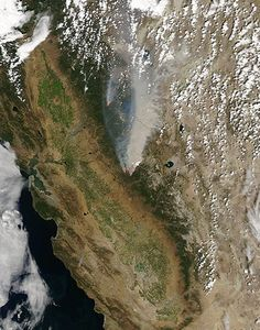Credit: MODIS/Aqua/NASA On 22 August 2013, the drought-fueled Rim fire burning in central California, near Yosemite national park. On 17 August, the fast-moving fire had already charred more than 100,000 acres (40,000 hectares) by 23 August, despite the efforts of more than 2,000 firefighters. Hundreds of people were forced to evacuate their homes, and roads in the area were closed. As of 23 August, no structures had been reported destroyed, but the fire threatened the towns of Groveland and…