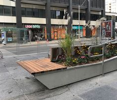 This Petra Design Precast concrete bench doubles as a flower bed. Concrete Bench, Precast Concrete, Stone Planters, Cast Stone, Petra, Ontario, Interior And Exterior, It Cast, Urban
