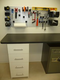 Garage work bench with slatwall for tools and supplies.