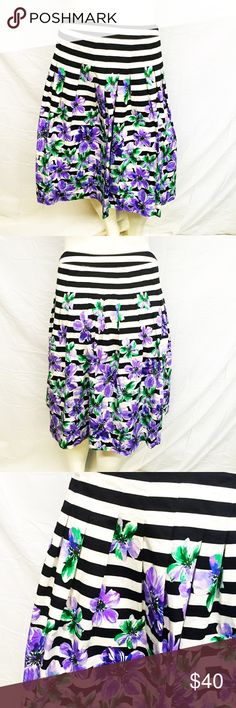 Beautiful Talbots Circle Skirt This is a gorgeous floral circle skirt from Talbots. Purple flowers on a black and white background. Side zipper. This will give your wardrobe some color! Perfect for a wedding or a spring/summer event. In perfect preowned condition. Smoke and pet free home. Talbots Skirts Circle & Skater