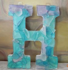 Definitely how we will put her name in the room Sea glass letters. Cute for a beachy nursery LOVE!