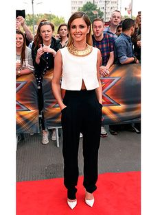 A big fan of the trousers, Cheryl wore some high-waisted slim fit black trousers to the fourth round of auditions. Teaming it with a cute little white sleeveless top, she breaks up the outfit's monochrome with a striking gold necklace that Cleopatra would be proud of.  -Cosmopolitan.co.uk