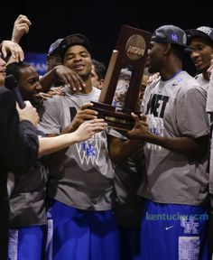 Aaron Harrison and team holding the Midwest Regional trophy. On to the Final Four! Kentucky takes down Michigan on Aaron Harrison three-pointer | Basketball: Men | Kentucky.com