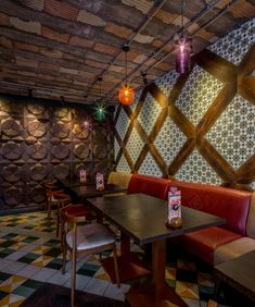 Restaurant | Nando's Headingley, Leeds, UK by Moreno Masey Architecture + Interiors. Fast Casual Restaurant Design. Reclaimed timber panelling with red leather banquettes and intricate tile and timber panel patterns.