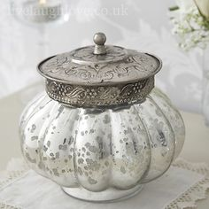 Pretty antique glass jar with pearl brooch and ornate metal lid. Perfect for storage but looks lovely as a decorative piece. A beautiful addition to your shabby chic home.