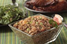 Almonds and pinenuts enhance the nutty flavor of quinoa in this easy side dish.