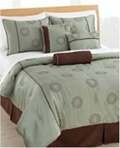 "Pem America Sun Dial Queen Comforter Set w/ Bonus Pillows, Green, Queen by Pem America. $59.99. A soothing sea green background is the base for embroidered starbursts. The coordinating chocolate color give depth to the ensemble and highlights the lines of the pattern. Dimensions:  Queen: 1 queen comforter (90"" x 92""), 2 std. shams (20.5"" x 26"" inches), bed skirt (60"" x 80"" +14"" drop), 1 neckroll pillow (6"" x 16""), 1 square pillow (16.5"" x 16.5""), 1 breakfast pil..."